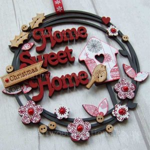 Home Sweet Home hanging sign with layered words, birdhouse and flowers.